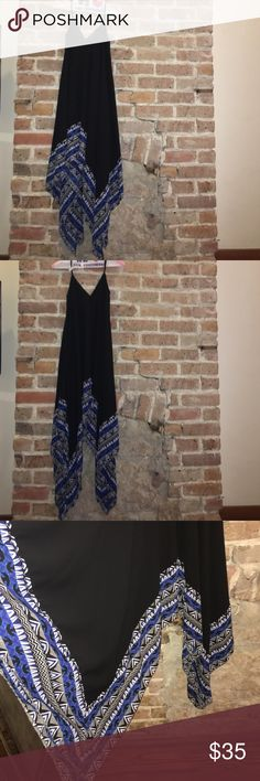 Flowy Maxi Dress From Express. Perfect condition. Dry cleaned. V-neck and back. Super flowy skirt bottom. The large amount of material falls beautifully around the body. Shorter in the front and back and longer on the sides. Super fun! Black with blue and white tribal pattern. Adjustable straps. Express Dresses Maxi