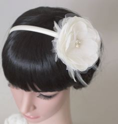 Ivory / white bridal fascinator headband with a silk flower made of silk and tulle. Stitched to an ivory headband, polka dot tulle, and fine feathers. Entirely handcrafted bridal headband. Visit my Etsy shop to see this and other accessories for brides, weddings, proms, and other special occasions.