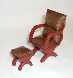"""Brown """"leather"""" upholstery chair & matching footstool, wooden arms.  1 to 12 dollhouse scale miniature."""