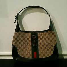 PRICE DROP100 % Authentic Gucci Handbag 100% Authentic Gucci Handbag.  Minor wear as shown in pictures.  Chocolate leather surrounds the classic Gucci colors on this nice bag with silver hardware.  Great addition to any wardrobe. Gucci Bags Shoulder Bags