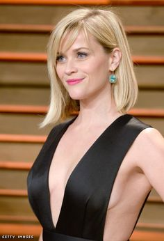 Reese Witherspoon impressive cleavage in a revealing gown at Oscar after party.