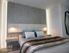 On both sides of this bed, we find the Nón Lá suspension in white brilliant lacquer which integrates perfectly with the warm tones and textures of the overall space.  Its simple open cone offers us a light structure that is resistant and a bit avant-garde, thanks to the decentralization of its light cavity. Bedroom Lighting, Warm, Space, Simple, Furniture, Home Decor, Floor Space, Decoration Home, Room Decor