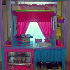 Entertainment center transformed into a play kitchen!