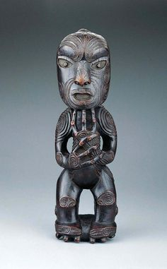 Standing Ancestor Figure is a wood sculpture from the Maori culture. he figure represents either a god or a recently deceased male ancestor with a with an intricate curvilinear pattern of face tattoos (moko) that decorate the faces of Maori chieftains. Maori Face Tattoo, Maori Tattoos, Face Tattoos, Ancient Art, Ancient Aliens, New Zealand Art, Maori Tattoo Designs, Maori Art, Kiwiana