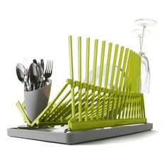 Dish Drainer - Made from high-tech polypropylene and stainless steel. Keeps dishes in line and includes a wave of spikes to hold delicate champagne flutes upright. Built into the drainage tray is a flip-up spout, letting you choose to drain or not to drain based on what your space allows. Folds flat for storage.