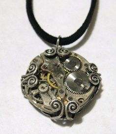 Image of Wire Wrapped Steampunk Watch Movement Necklace found at http://www.grouseandbadger.com/product/wire-wrapped-steampunk-watch-movement-necklace#