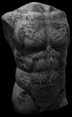 TATTOO IN RUSSIAN PRISON...IT'S PARTICULAR JARGON OR DISCOURSE IN WHICH EVERY SIGN HAVE PARTICULAR AND PRECISE MEANING...THIS SUBJECT IS WELL EXAMINED AND YOU COULD SEE FEW VERY GOOD DOCUMENTARY ON YOUTUBE WITH GOOD EXPLANATIONS FROM CRIMINALS WHO CARE CERTAIN KIND OF TATTOO