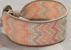 This handwoven, sparkly, faded coral and tan loom bracelet is beautiful for everyday wear or for a special occasion. It is woven with high quality nylon thread for strength, uniform delica seed beads