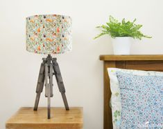 Woodland Animal Lampshade by Ceridwen Hazelchild Design, the perfect gift for Explore more unique gifts in our curated marketplace. Tripod Table Lamp, Bedside Lamp, Woodland Bedroom, Mountain Nursery, Elephant Canvas, Ceiling Shades, Free Motion Embroidery, Standard Lamps, Ceiling Pendant