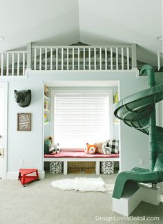 Spotted: Tempaper Repurposed Wood applied horizontally!  Check out all of the details of this Cutest Camping Lodge Playroom with awesome reading nook & indoor slide!