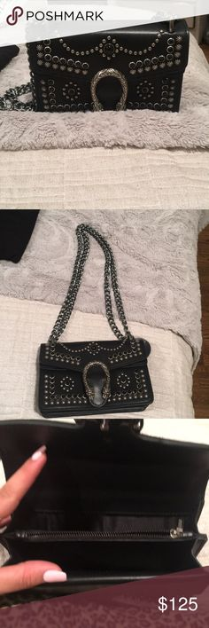 Black bag Beautiful black bag with stud detail and horseshoe emblem. This bag is so cute. It was given to me as a gift. Price r e f l e c t s- so gorg and the perfect size! Brand new Gucci Bags Shoulder Bags