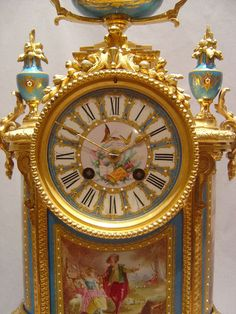 French antique blue celeste jewelled porcelain and ormolu with silver highights mantel clock Riveted to the back of the case is a presentation inscription beautifully engraved indicating to whom this clock was given and dated 1875