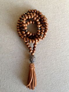 Wood and Pyrite Necklace with Pave Bead and Leather Tassel Pendant by Goldenstrand Jewelry