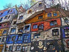 """Hundertwasser House, Viena . Built in the early 80's with charming uneven floors and an eco-friendly grass roof. The artist who designed it free of charge wanted to make sure something """"ugly"""" wasn't erected."""