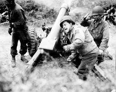 American howitzers shell German forces retreating near Carentan, July 11, 1944