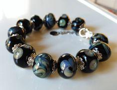 Handmade Beaded Lampwork Bracelet with Black and Silver Glass Tiny Necklace, Handmade Beads, Bead Caps, Black Glass, Bracelet Making, Glass Beads, Cuff Bracelets, Cuffs, Pendants