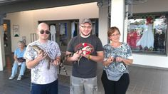 Boys and me holding gaters in Florida.  Christmas 2012.