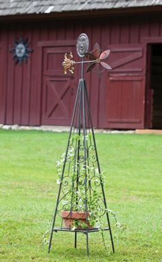 """Garden Hardware,Trellis with Weathervane and Plant Stand with sun detail by Ashley Gifts. $89.99. A unique and decorative piece. Made of metal. Approximate dimensions are 17.5"""" x 13"""" x 58.25"""". Great for yourself or as a gift. This metal outdoor accent piece is multi funtional! The base of this piece can hold a potted plant, which can then grow up the sides of the trellis. The top is decorated with a weather vane, giving this piece some extra eye-catching charm. A wonder..."""