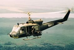 Navy Helicopter in Vietnam: On January 1968, sighting the enemy, the door gunner aboard a Huey helicopter opens fire on a target below in th...