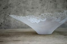 Exquisite paper bowl that resembles a leaf decomposing after it has fallen to the ground.