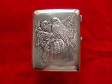 Antique Russian silver cigarette case depicting a bird's nest, dated at about 1908
