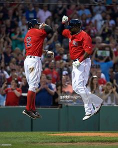 David Ortiz #34 of the Boston Red Sox celebrates with teammate Xander Bogaerts #2 after he hit a two-run home run during the fourth inning against the Seattle Mariners at Fenway Park on June 17, 2016 in Boston, Massachusetts.