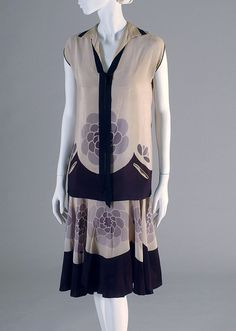Ivory silk crepe day ensemble from American circa 1925. Kent State University Museum. Accession Number: 2001.8.1 a-c.