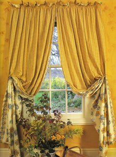 Laura Ashley curtains with scalloped leading edge, blanket stitched detail.