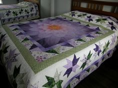 A couple of years ago my younger daughter requested that I make her a purple and green quilt. When she saw the Dream Big panel that I had quilted (see Purple Quilts, Green Quilt, Peacock Quilt, Fabric Panel Quilts, Fabric Panels, Big Block Quilts, Queen Size Quilt, Flower Quilts, Quilt Labels