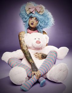 Concept: Doll, use of bright colours, stuffed toys, expressive posing, candy (large lollipop?), could use strings to create 'marionette'