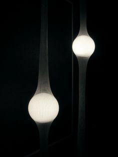 .:: The height of this glowing globe lamp can be adjusted in a net. ::.FUKUSADA DESIGN : Ryosuke Fukusada