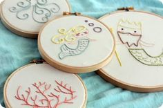 mermaid/sea-themed embroidery.....so beautiful and sweet for a little girl's room. Perfect with some Heather Ross mermaid fabric....