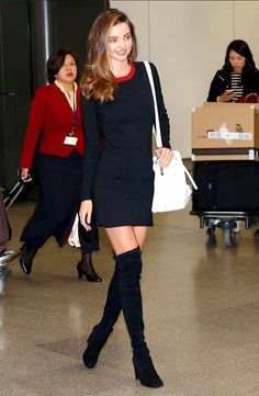 Miranda Kerr in a flirty navy mini dress and thigh-high black boots
