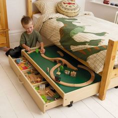 This play table under the bed not only provides a useful play area in your busy bedroom, but also reveals more storage space for toys. http://hative.com/creative-under-bed-storage-ideas-for-bedroom/