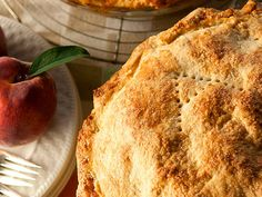 Labor Day movie: How to Bake a Peach Pie Makes 1 9-inch pie  3 lbs. peaches, peeled and sliced ¾ cup plus 1 tbsp. sugar, divided 2 tbsp. fresh lemon juice ¾ tsp. ground cinnamon 4 tbsp. quick-cooking tapioca, divided 3 cups all-purpose flour, plus more for dusting ¾ tsp. salt ½ cup vegetable shortening 1 stick plus 1 tbsp. chilled butter, cut into pieces ⅓ to ½ cup ice water 1 beaten egg
