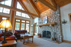 custom built wood burning fireplace in this hybrid log home