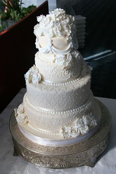 Champagne and white fondant cake with sugar flowers