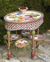 whimsical McKenzie Childs side table. Love!