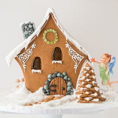 Of course, what fairy gingerbread house would be complete without a fairy to live in it? Meet Cinda. Cinda is made entirely out of marzipan, pulled sugar, and of course, fairy dust
