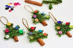 Christmas ornaments-trees made with cinnamon sticks, greens and buttons for decorations.