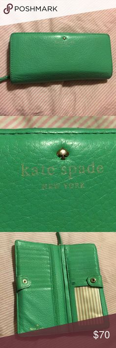 Kate Spade Bifold Wallet with clasp Slight wear on interior. Exterior in excellent condition. Ask for more pics kate spade Bags Wallets