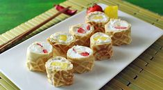 Breakfast sushi: waffle roll, strawberries, pineapples, and whipped cream. 17 Cooking Projects Ain't Nobody Got Time For