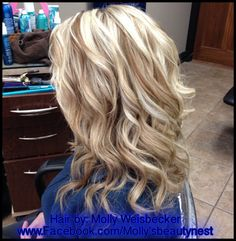Platinum blonde hi-lights with golden blonde lowlights. Curls styled with Working Spray from Aquage.