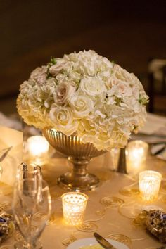 This will probably not happen, but love the look for an alternative as centerpieces, with a little bit of lavender thrown in