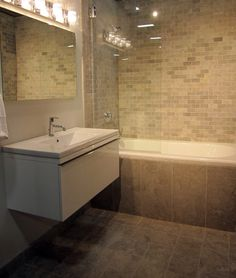 A masculine contemporary bathroom. #marble #thetileshop