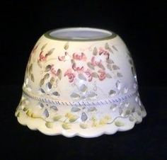 Home Interiors Candle Shade Topper Sweet Pea Ivory Green Pink  Beautiful Victorian Style Jar Candle Shade made by Home Interiors. Ivory glaze with pink and yellow flowered vines and scalloped bottom rim adds to the detail. Measures 6 inches in width, 3.75 inches high and 2.75 inch opening in the top. Candle shades not only dress up your candle decor, they also help combat soot that might otherwise make it's way to your ceilings and surrounding walls.