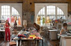 workroom- windows, wall spaces, portable work tables, raw walls, plain floor, good lighting. Probably want skylights