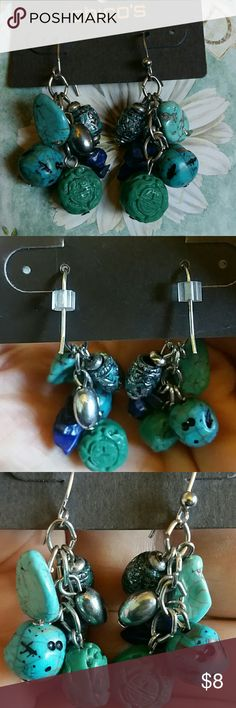 Chico's Charm Drop Earrings Silver drop earrings with uniqye silver, turquoise and blue charms. Worn twice. Silver bead on one of the earrings is missing, but barely noticeable.  Beachy. Tribal. Chico's Jewelry Earrings
