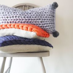 Brand new Limited Edition Chunky Knit Cushion collection by Lauren Aston designs with blues, greys and pops of coral. Add pompoms on to the oblong cushion for tactile character or keep it plain for simplistic Scandinavian style.