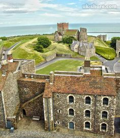The church and Roman lighthouse at Dover Castle, Kent, England. View from the main tower looking towards the English Channel and the French coast